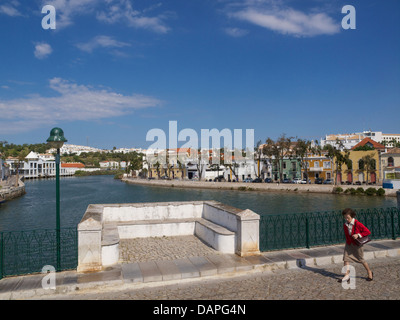 View on the town of Tavira from the Roman bridge over the river Sequa. Algarve region, Portugal - Stock Photo