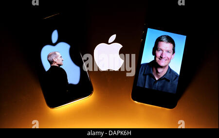 ILLUSTRATION - A photo of Apple head Steve Jobs on an Apple iPhone 3Gs (L) and of his successor Timothy D. Cook - Stock Photo