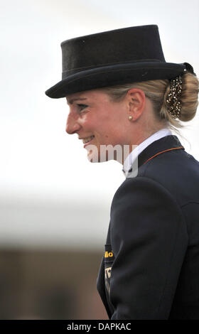German eventing rider Julia Mestern smiles during the dressage event of the European Eventing Championships in Luhmuehlen, - Stock Photo