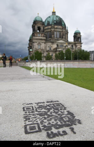 A so-called QR code ('Quick Response') is written on the ground at Palace Square in Berlin,Germany, 30August 2011. - Stock Photo