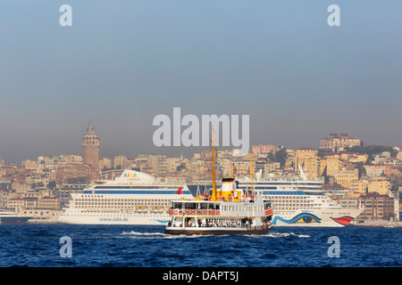 Turkey, Istanbul, View of ferry boat and MS AIDA diva cruise liner on Bosphorus - Stock Photo