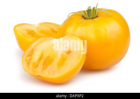 tomato orange cut half on white background - Stock Photo