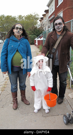 Costumed family trick-or-treating in the Kensington section of Brooklyn, NY, 2011. - Stock Photo