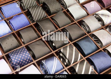 Ties on a shelf display in a boutique store in Melbourne, Australia - Stock Photo