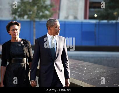 epa02909561 US President Barack Obama, and First Lady Michelle Obama walk along the North pool of the 9/11 Memorial - Stock Photo