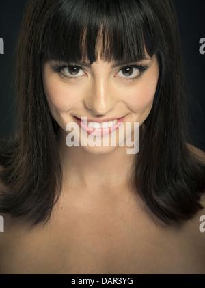 Beautiful latina woman dark brown brunette hair high cheekbones big smile. - Stock Photo