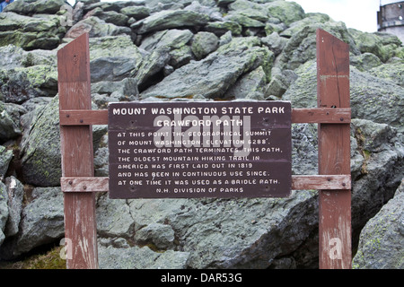 A sign indicates the end of the Crawford Path at the summit of the Mount Washington in New Hampshire - Stock Photo