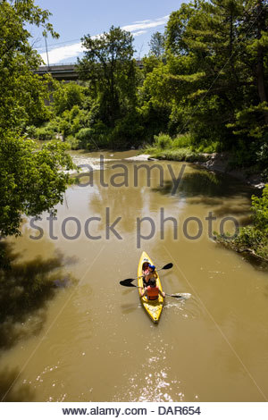 Kayak on the Rouge River in Rouge National Urban Park an urban wilderness inside Toronto Ontario Canada - Stock Photo