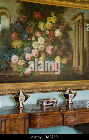 Still-life painting of flowers above antique console table in Ampney Park, 17th century English country house - Stock Photo