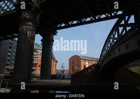 England, Manchester, Victorian Railway line and footbridge silhouetted in Castlefield district - Stock Photo