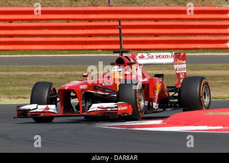 Silverstone, UK. 17th July, 2013. Scuderia Ferrari F138 driven by Davide Rigon during the Formula One young drivers - Stock Photo