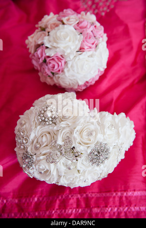 White Fabric Bridal Bouquet with Butterfly and Flower Diamanté brooches and Pastel Pink and White Wedding Bouquet - Stock Photo