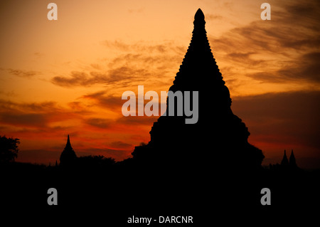 Silhouette of pagodas in Old Bagan at dusk. - Stock Photo