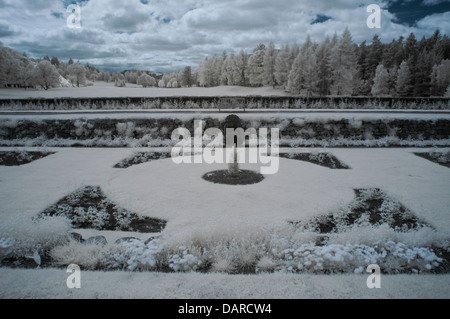 Horizontal Infrared image of gardens in front of Balmoral Castle, Royal Deeside, Scotland, UK with trees and clouds. - Stock Photo
