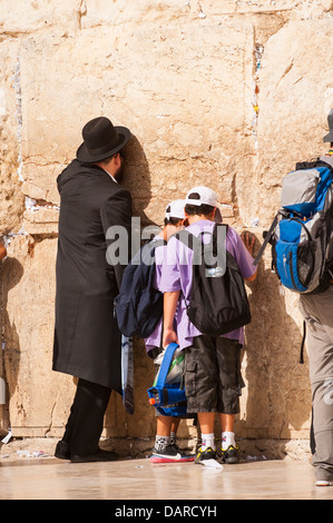 Israel Jerusalem Old City Wailing Western Wall Ha Kotel Plaza Hasidic Chabad orthodox Jew Jewish man young boys - Stock Photo