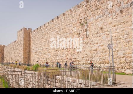 Israel Jerusalem Old City Wall ramparts battlements leading to Jaffa Gate blue sky busy pedestrians people - Stock Photo