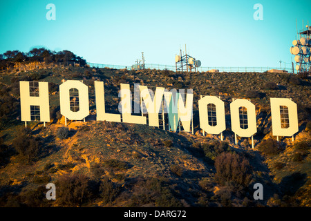 The iconic Hollywood sign with a blue sky background - Stock Photo