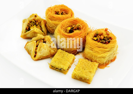Assortment of Arabic baklava with pistachios. Traditional Arabic dessert. - Stock Photo