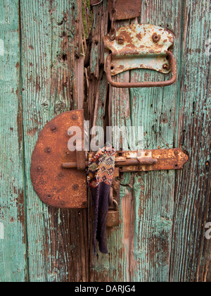 Africa, Eritrea, Massawa, Old Town, rusting bolt on old green painted house door - Stock Photo
