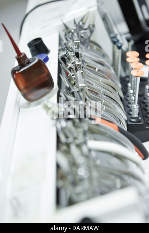 Different pliers and tools in optician workshop - Stock Photo