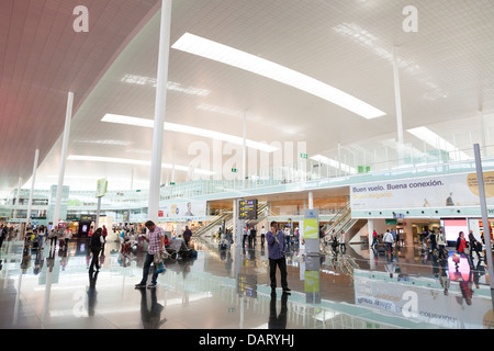 shopping area in departure hall of Barcelona Airport - Stock Photo