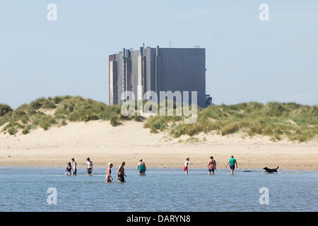 Thursday, 18th, July, 2013. North Gare beach near Seaton Carew, Hartlepool, England, UK. Bathers cooling off in - Stock Photo