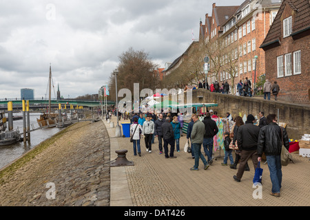 BREMEN - APRIL 27: Unknown shopping people at a street market near the river Weser on April 27, 2013 in Bremen, - Stock Photo