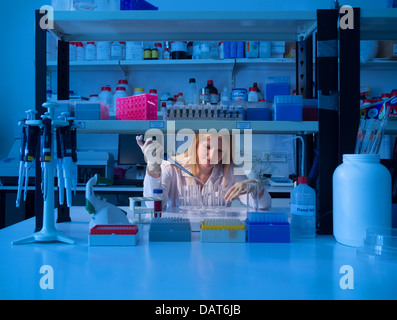 Scientist working in lab - Stock Photo