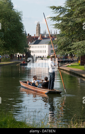 Punting in Cambridge UK along the River Cam towards the Millpond on a sunny summer day. - Stock Photo