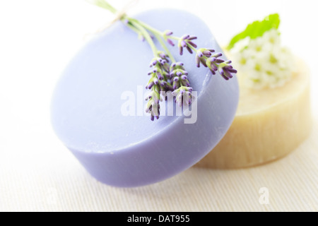 Handmade soap with fresh lavenders and white flowers - Stock Photo