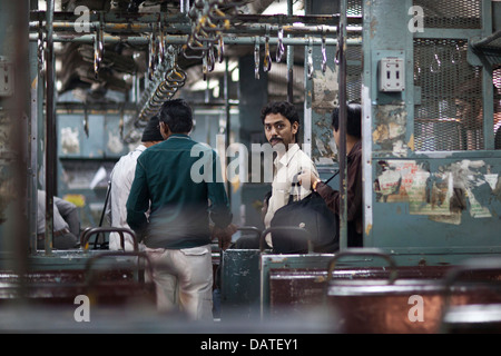 A portrait of a passenger on a commuter train in India