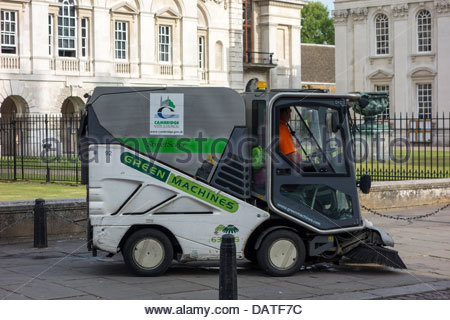 Cambridge City Council street cleaning machine on Kings Parade in Cambridge in the early morning - Stock Photo