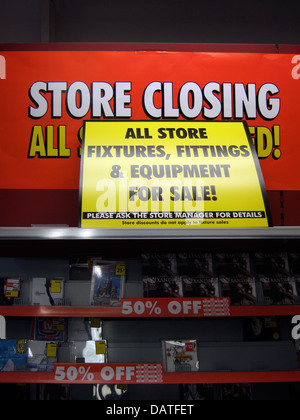 Store closing down signs, during recession. - Stock Photo