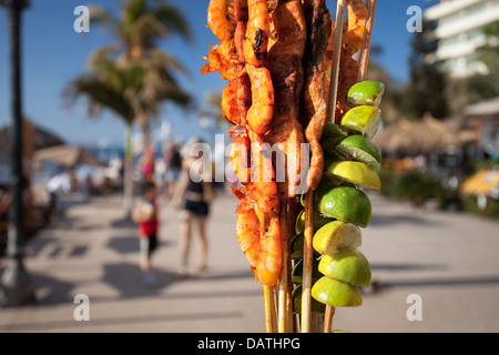 Shrimp on a stick for sale on the malecon in Puerto Vallarta, Mexico. - Stock Photo
