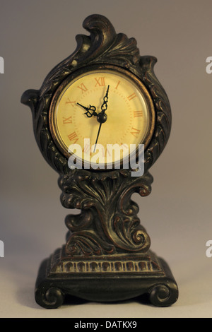 Antique looking clock with Roman Numerals - Stock Photo