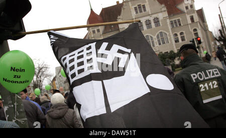 Green balloons reading 'No to neo-Nazis' and a black flag pictured at a manifestation against rightist-extremism - Stock Photo