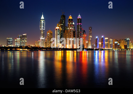 Dubai Marina, UAE at dusk as seen from Palm Jumeirah, this skyline view is simply spectacular - Stock Photo
