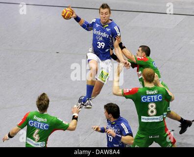 Filip Jicha (C) of Lemgo delivers the ball during the Handball Bundesliga match SC Magdeburg v TBV Lemgo at the - Stock Photo