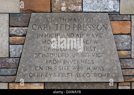 A plaque at the site of Orkney's first airport on the outskirts of Kirkwall records the inaugural flight by Capt - Stock Photo