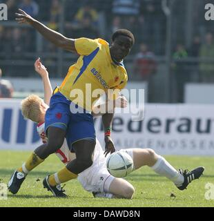 Braunschweig's player Valentine Atem (front) and Freiburg's Andreas Ibertsberger shown in action during the Bundesliga - Stock Photo