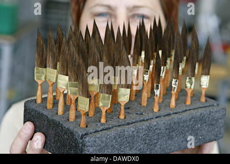 Employee Manuela Scharf shows special brush tips at the artist's brush factory Defet Gmbh in Nuremberg, Germany, - Stock Photo