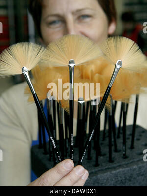 Employee Manuela Scharf shows cosmetics brushes at the artist's brush factory Defet Gmbh in Nuremberg, Germany, - Stock Photo