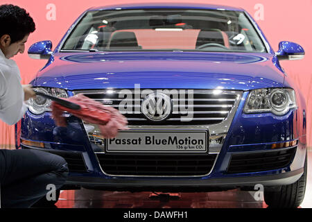 The picture shows a Volkswagen (VW) Passat BlueMotion getting polished during the car show 'AMI' (Auto Mobil International) - Stock Photo