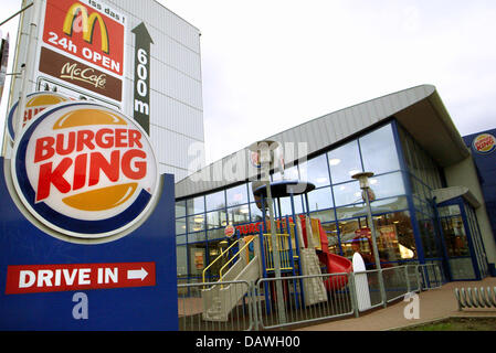 The logos of leading fast food chains Burger King (bottom L) and McDonald's (top L) pictured in Hamburg, Germany, - Stock Photo