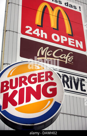 The logos of leading fast food chains Burger King (bottom) and McDonald's (top) pictured in Hamburg, Germany, 10 - Stock Photo