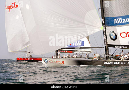 The US-American yacht  BMW Oracle(R) sails against the Italian yacht Luna Rossa at the fourth race of the Louis - Stock Photo