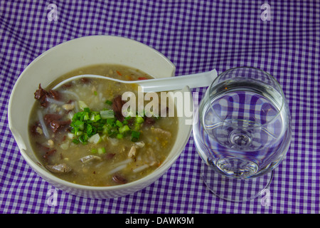 Rice Worm Soup , Kao Paick sen Traditional Thai style food and glass for breakfast - Stock Photo