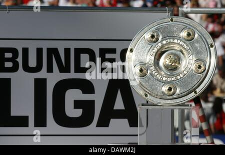 The Bundesliga trophy pictured with the logo of the Bundesliga at Gottlieb Daimler stadium of Stuttgart, Germany, - Stock Photo