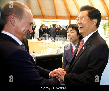 Russian President Vladimir Putin (L) shakes hands with Chinese President Hu Jintao at a session with the so-called - Stock Photo
