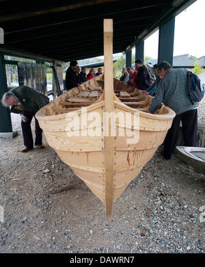 Visitors have a look at replicas of viking ships from the 11th century, which had been excavated from the Roskilde - Stock Photo